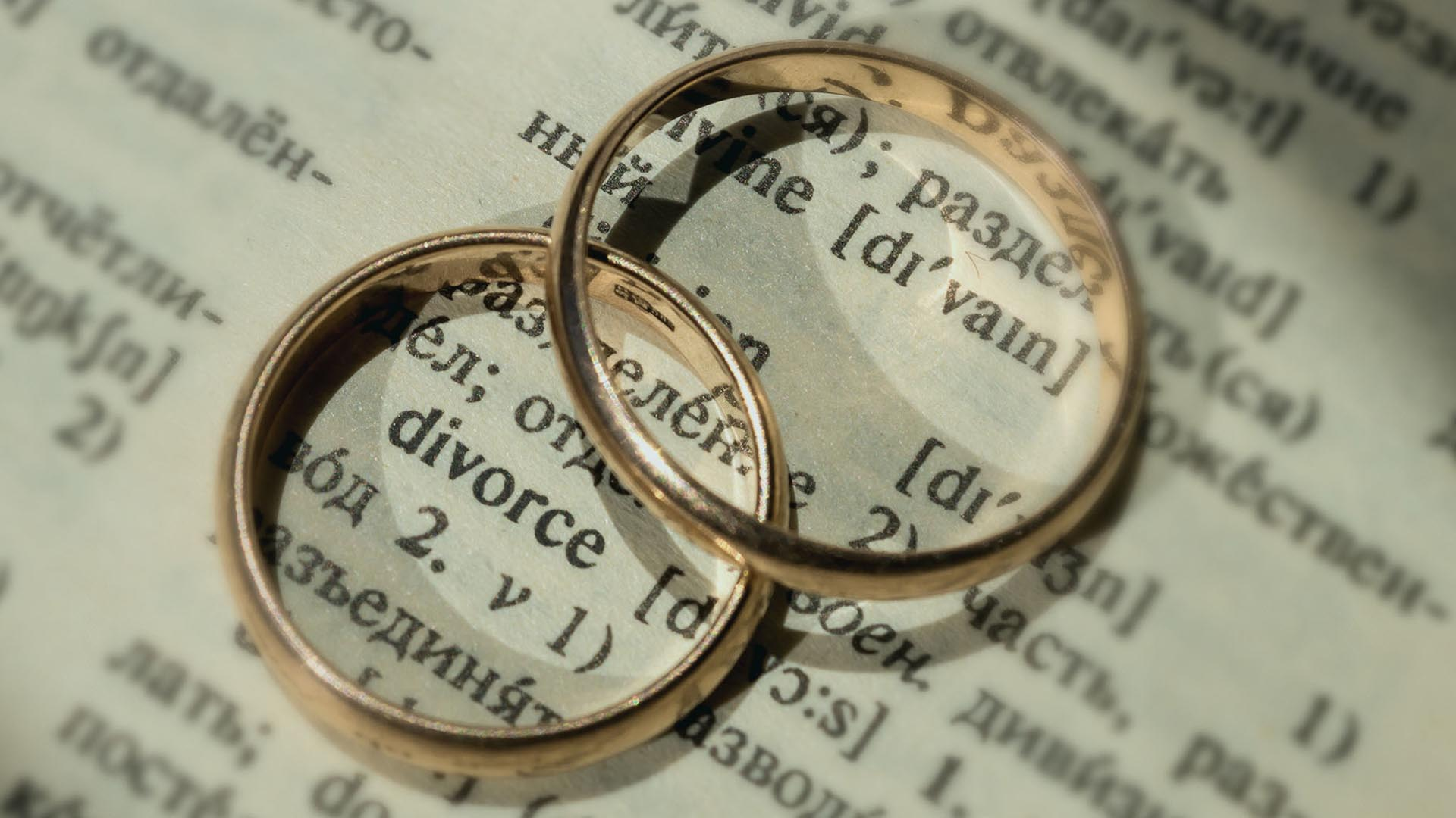 wedding rings on top of a dictionary open to the word
